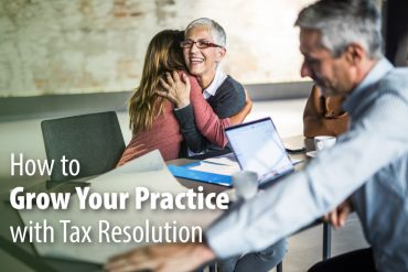 Happy tax resolution client hugging her accountant
